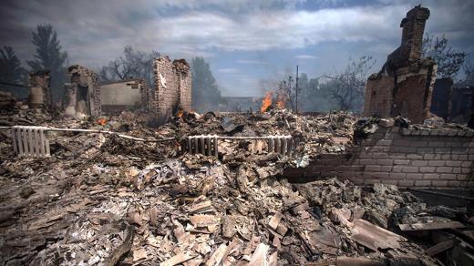 Maison détruite par une frappe aérienne de l'armée ukrainienne dans le village de Stanitsa Luganskaya le 2 juillet 2014 (photo AFP).