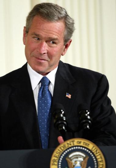 US President George W. Bush makes a few