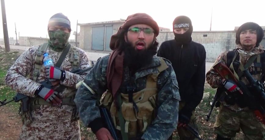 Militants du groupe ouzbek Katibat al Tawhid wal Jihad lors des combats à Tal Bajir au sud d'Alep